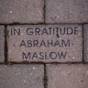 """Photo of a brick paver that engraved with the message, """"In gratitude: Abraham Maslow"""""""