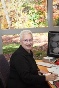 Photo of Dr. Diane Blau sitting behind her desk in her office.