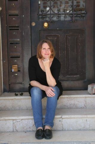 Photo of Dr. Miriam Engstrom sitting on steps.