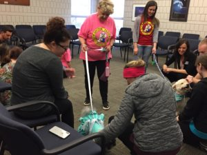 Students visit with therapy dogs.