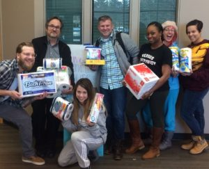 IDEA members holding donations.
