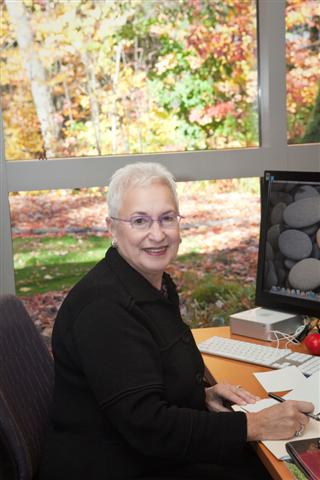 Diane Blau at desk