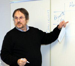 Photo of Kevin Keenan, PsyD teaching at board
