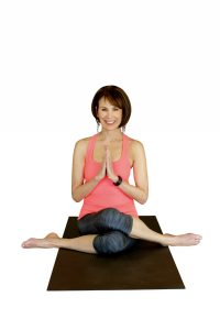 Ronda Diegel in a seated yoga pose.
