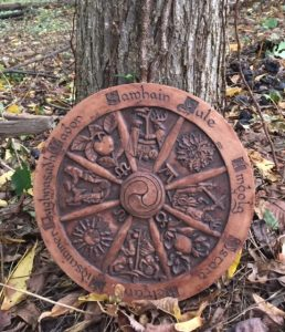 Pagan wheel resting against a tree.
