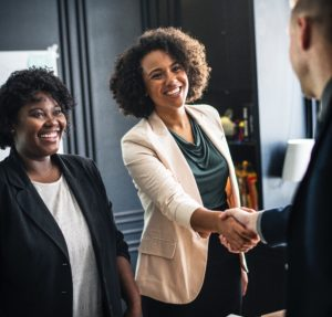 stock photo business people shaking hands