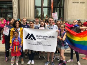 Group of MSP students holding banner at Pride.
