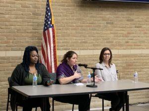 Photo of three MSP students talking on panel.