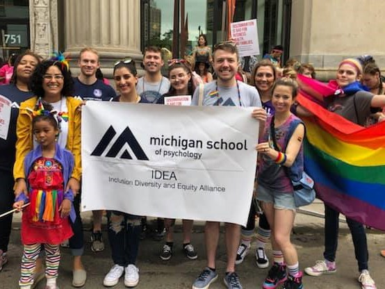 Group of MSP students and family holding banner at Pride Parade.