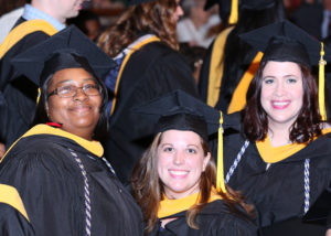 Photo of students at MSP's graduation ceremony wearing their graduation regalia.